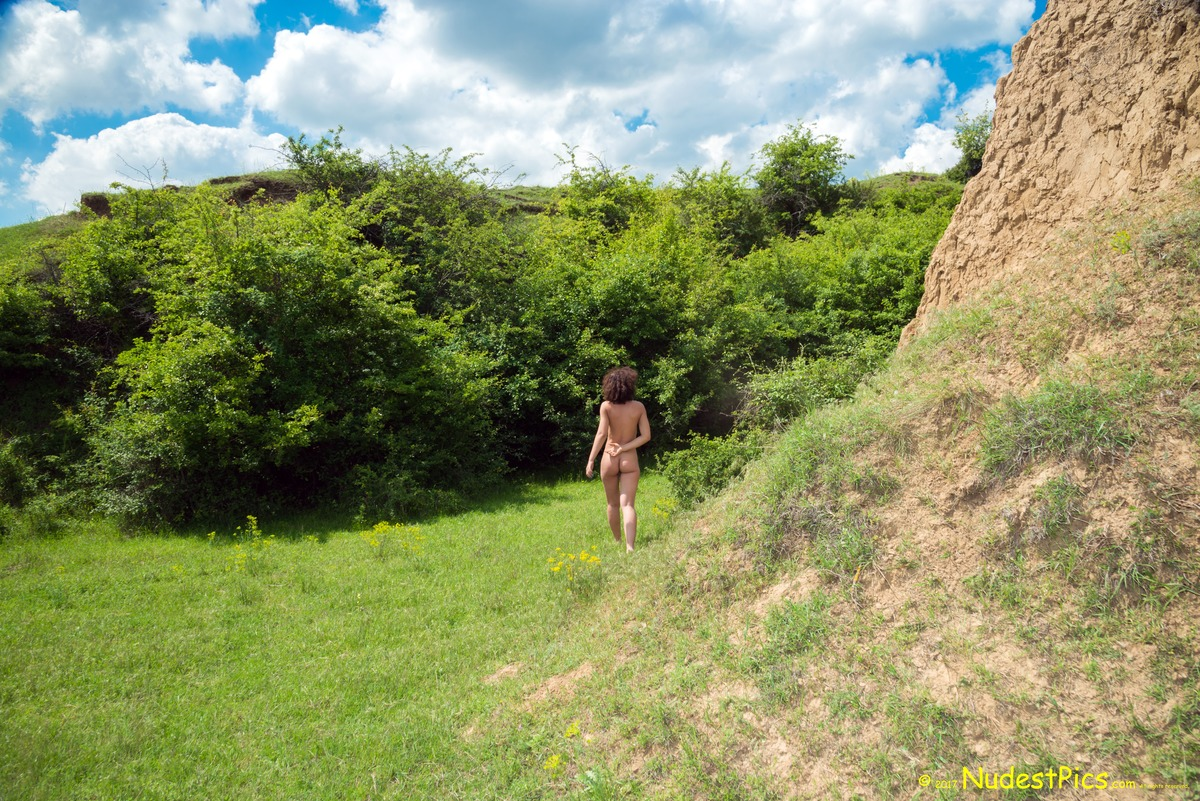Candid Photo of a Naturist Girl Walking