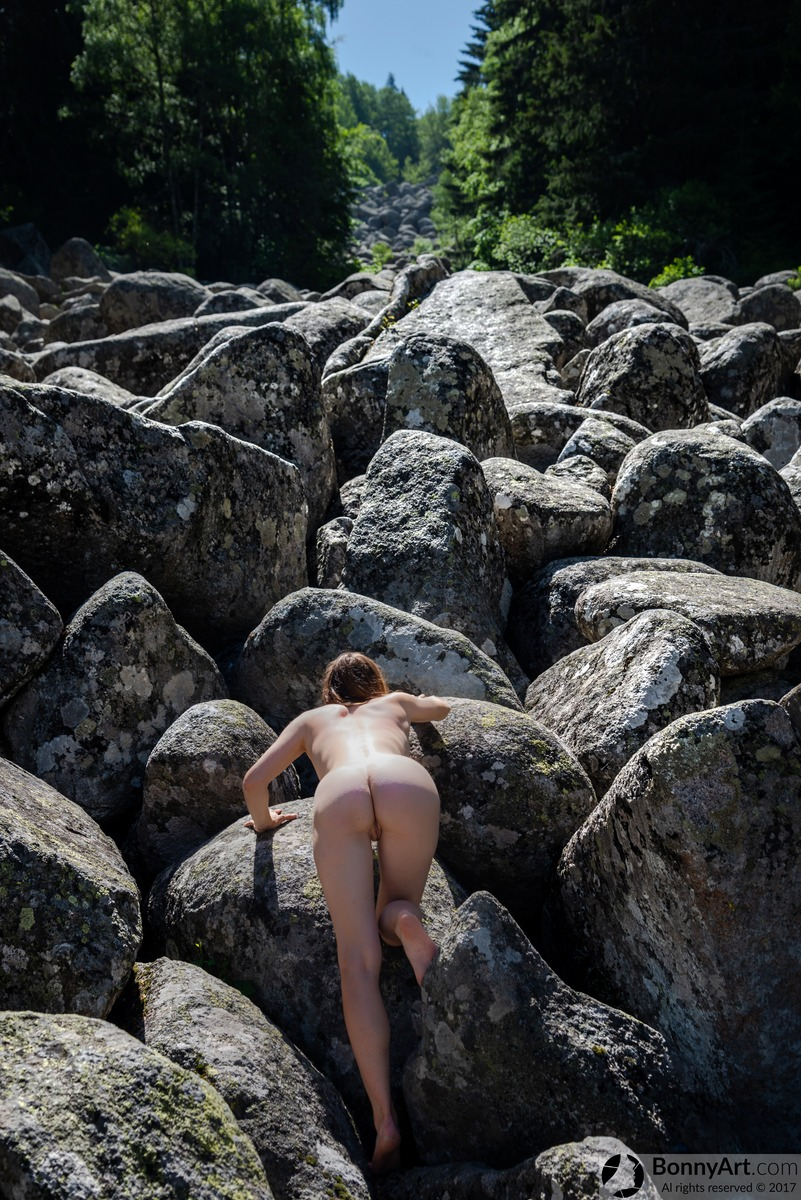 Naked Girl Climbing the Rocks Stream