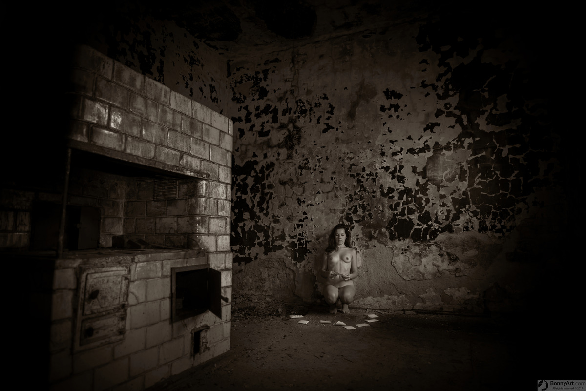 Nude Girl Reading Old Postcards in Haunted House