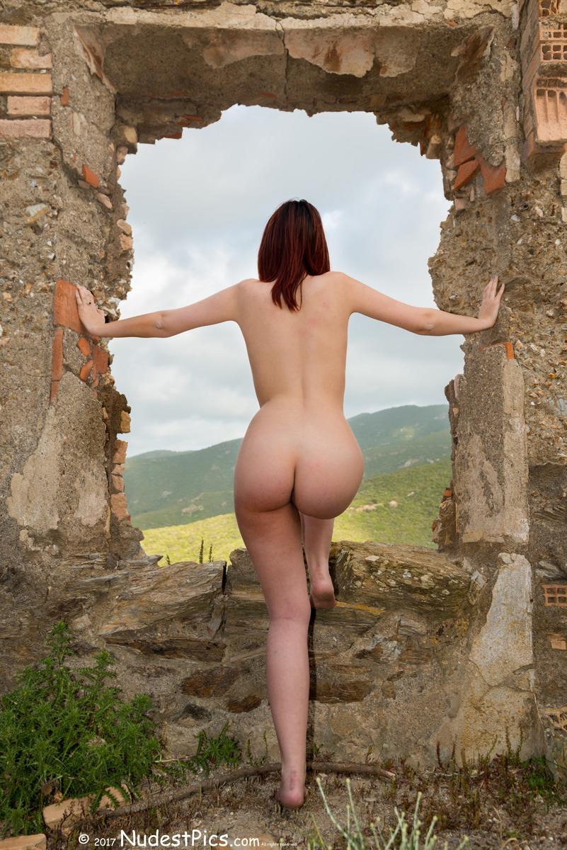 Nude Girl Watching Nature through Ruined Window