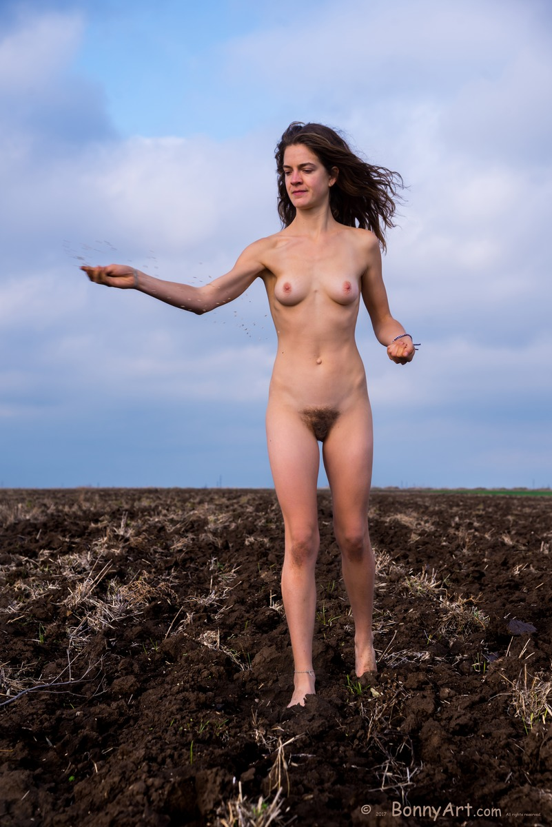 Nude Woman Sowing Wheat in the Field