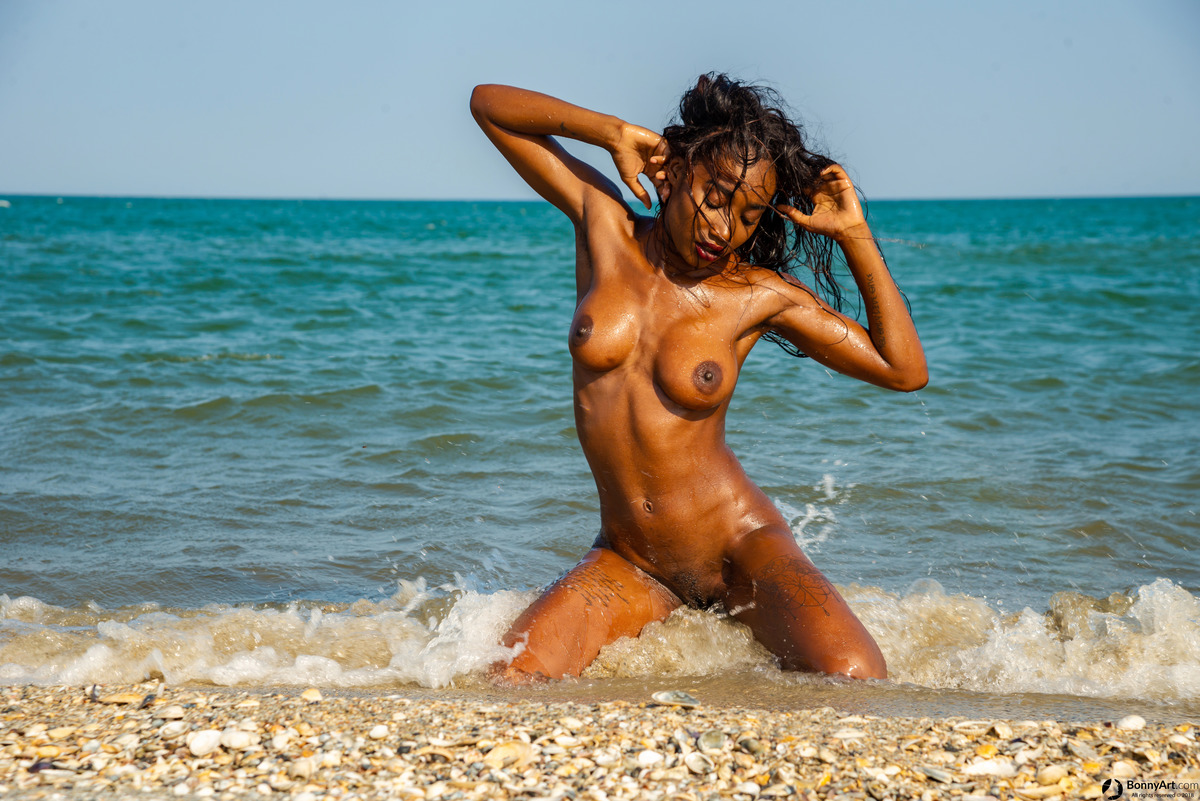 Beautiful African Girl Model Wet on the Beach