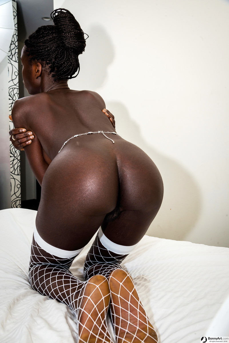 African Ebony Girl Bending Over Kneeling