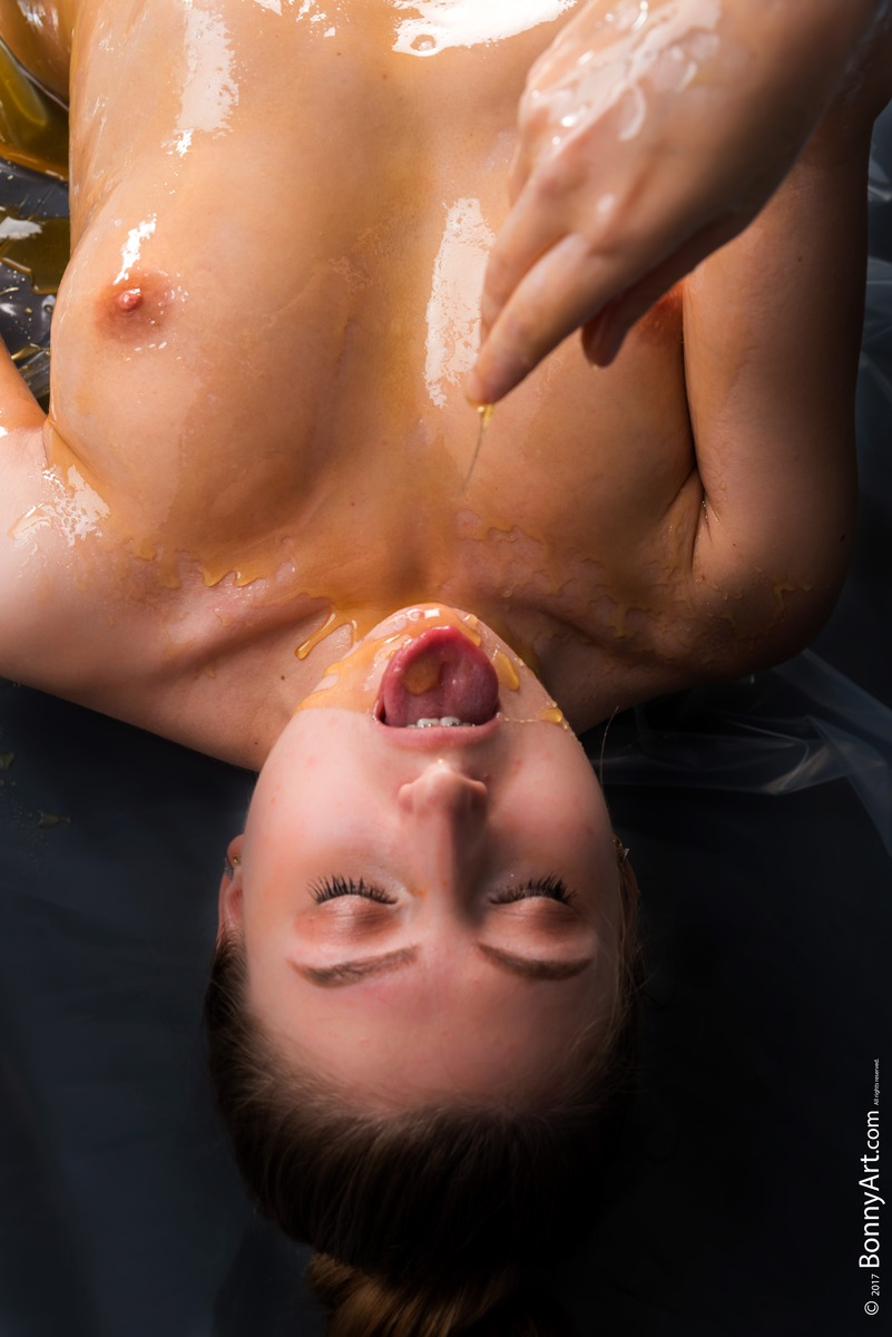 Topless Girl Covered in Honey Eating It