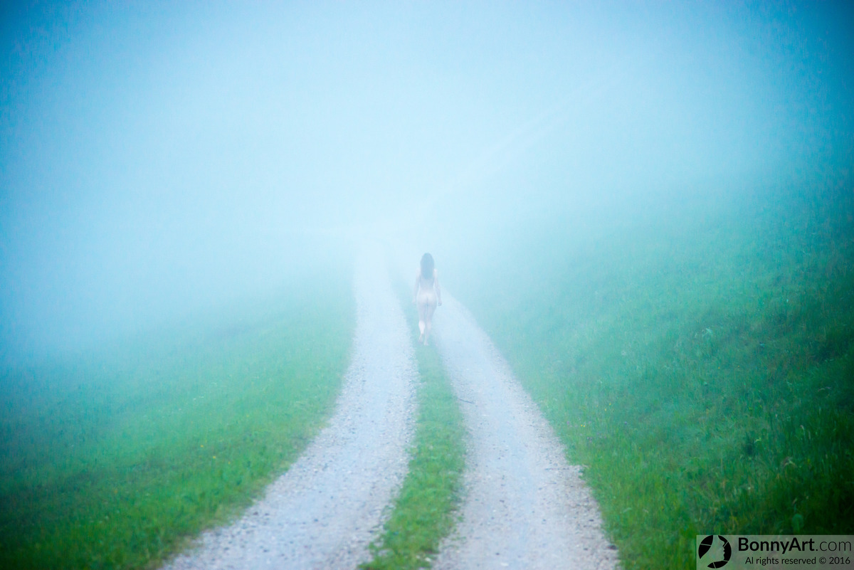 Nude Woman Running on Misty Mountain Road